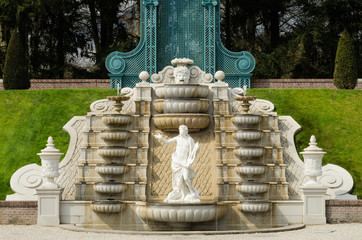Cascading fountain with statue