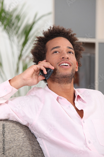 Man at home talking on the telephone