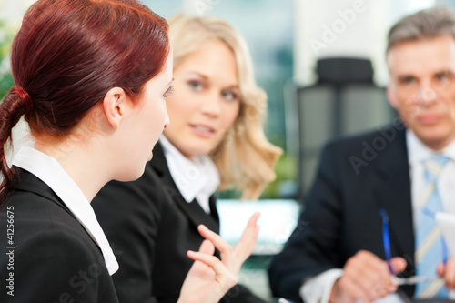 Business - team meeting in an office