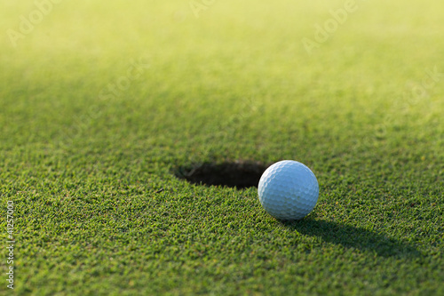 A golf ball and hole