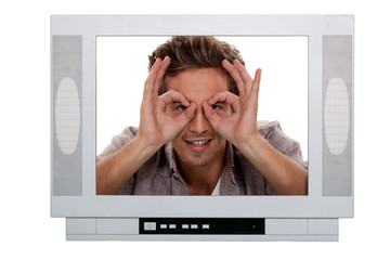 Man making a silly face inside a television frame