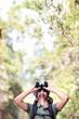 Binoculars - man hiker looking up