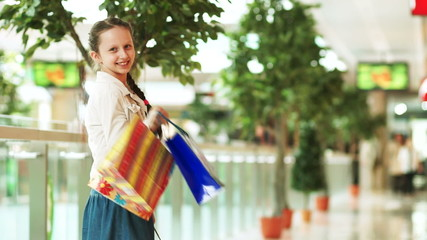 Preschool  girl with shopping looking at camera