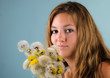 Spring: young woman with dandelions