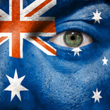 Flag painted on face with green eye to show Australia support