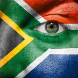 Flag painted on face with green eye to show South Africa support