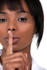 Woman holding her finger to her lips