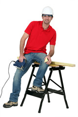 Man cutting a piece of wood with a jigsaw