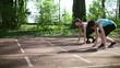 Two women running on track lane, slow motion, dolly shot