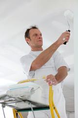 painter at work on ladder
