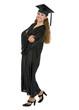 Full length portrait of happy graduation student woman