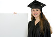 Happy graduation female student holding blank billboard