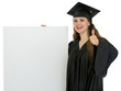 Happy graduation student girl holding blank billboard