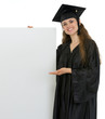 Smiling graduation student woman showing on blank billboard