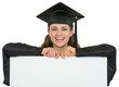 Happy graduation student girl with blank billboard