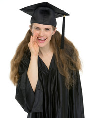 Smiling graduation student girl whispering good news