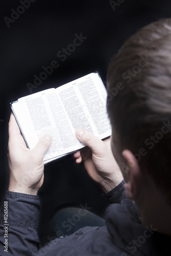 man on knees with bible