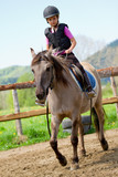 Horse riding - lovely girl is riding a horse - Fine Art prints