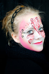Beautiful smiling girl with face paint