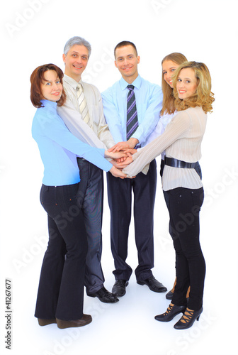 Smiling business people holding hands together in a