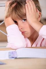 Girl tired of doing homework