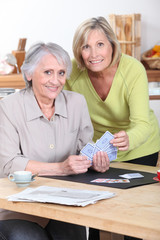 Older women playing cards