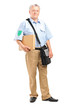 Full length portrait of a mature postman delivering a box