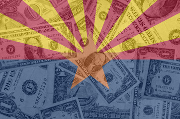 US state of arizona flag with transparent dollar banknotes in ba