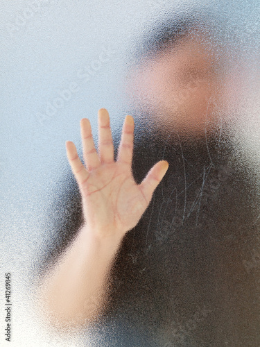 Silhouette of a man's body through frosted glassSilhouette