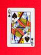 Old playing card (queen) isolated on a red background