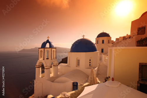 Santorini with famous churches against in Oia village, Greece