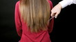 Hairdresser cutting very long hair