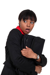 Scared businesswoman clutching folder