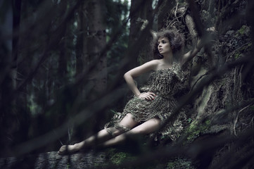 Eco lady lying on the trunk