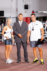 gym staff full length portrait