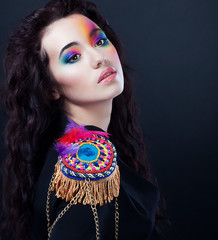 Woman in carnival uniform retro costume. Bright colorful makeup