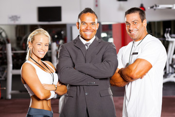 happy group gym manager and trainers