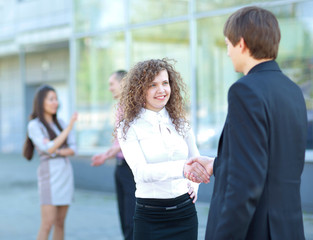 Business partners handshaking after negotiating