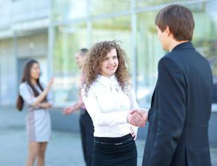 Business partners handshaking after negotiating