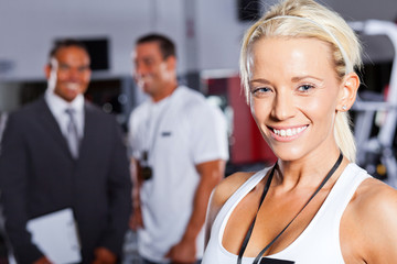 pretty female gym trainer closeup portrait