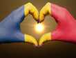 Heart and love gesture by hands colored in chad flag during beau