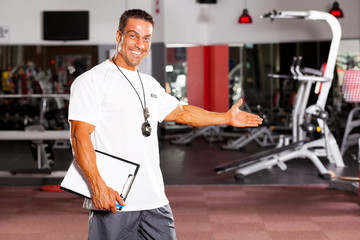 happy male gym trainer welcome customer