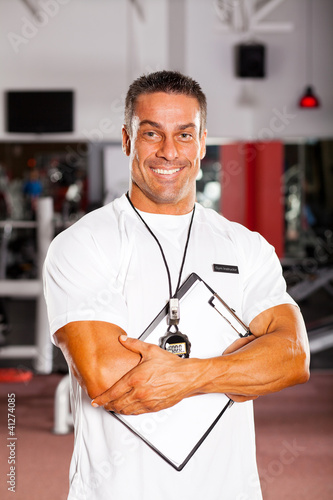 handsome professional gym instructor portrait