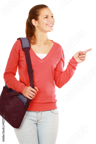 A college girl holding a bag and ponting of something