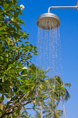 Shower on blue sky background