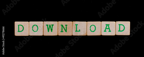 Green letters on old wooden blocks (download)