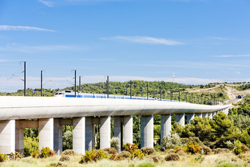 train of TGV on railway viaduct near Vernegues, Provence, France