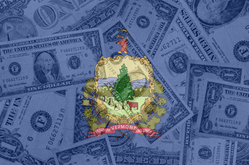 US state of vermont flag with transparent dollar banknotes in ba
