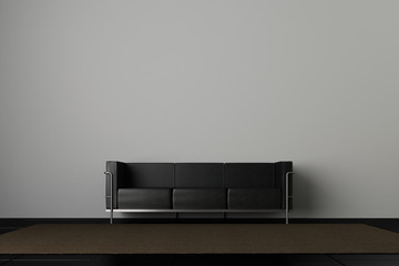Couch on grey wall