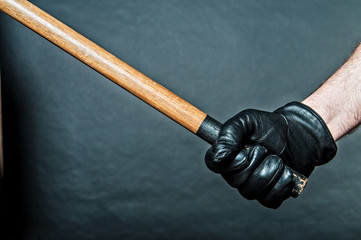 black leather glove and a stick